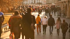 Blurred unrecognizable people walk along sunny spring street slow motion video - stock footage