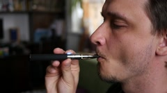 Man breathing out a smoke rings at home of electronic cigarette slow motion Stock Footage