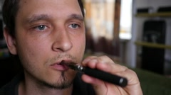 Breathing out a smoke rings in slow motion - man smoking electronic cigarette Stock Footage