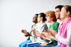 Students clapping hands Stock Photos