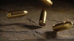 Bullets falling in slow motion - stock footage