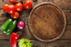 Various vegetables for pizza at wooden background Stock Photos