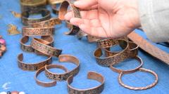 Choosing metal bracelet - stock footage