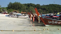 THAILAND, CIRCA 2015: Floating moored fishing boats in the emerald sea. Stock Footage