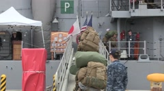 OKINAWA JAPAN, JANUARY 2016, US Navy Soldiers Walk Over Ramp To Ship Stock Footage