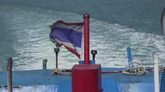 Thailand flag floating in the sea of the ship. Slow motion Stock Footage