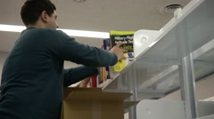 JAPAN, JANUARY 2016, Member Of Library Take Books In Shelf Stock Footage