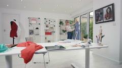 4K Fashion designer at work in creative studio - stock footage