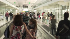 BANGKOK, CIRCA 2015: Passengers go through the large airport terminal hall Stock Footage