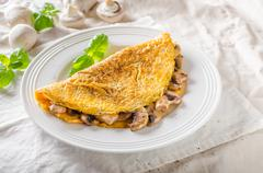 Rustic omelet with mushrooms - stock photo
