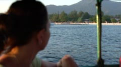 Young girl looking at seascape from moving boat. Slow motion - stock footage