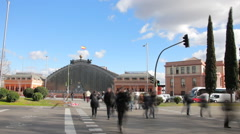 Cars and pedestrians front Atocha station in Madrid. Timelapse Stock Footage