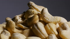 Pile of cashew nut kernels rotating - stock footage