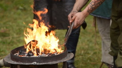 Smith and fire outdoor Stock Footage