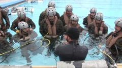 OKINAWA JAPAN, JANUARY 2016, US Navy Soldiers In Swimming Pool Trainer Stock Footage