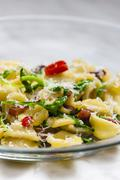Pasta orecchiette with ruccola and bacon Stock Photos