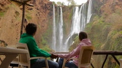Couple watching majestic Ouzoud Waterfalls. Man and woman visiting famous Stock Footage
