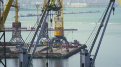 Uploading goods by cranes in the port of Odessa Stock Footage