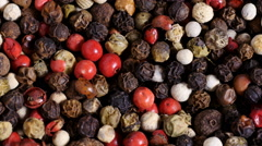 Mixed peppercorns overhead rotation Stock Footage