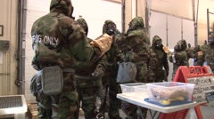 SIOUX USA, MARCH 2016, US Soldiers Trainee Decontermination Clean Each Other - stock footage