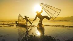 Fishermen with fishing net at Inle lake in Myanmar Stock Footage