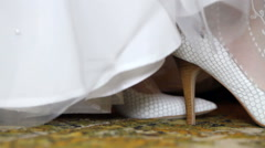 Bride dress white shoes close-up - stock footage