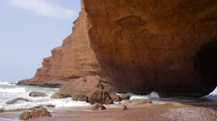 Seashore on legzira beach with natural arch Stock Footage