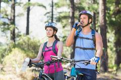 Adventurous young couple at forest - stock photo