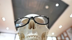 Human skull with glases close up view Arkistovideo