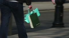 Shopping bag on busy city streets Stock Footage