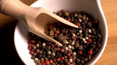 Mixed peppercorns in bowl, zoom in - stock footage