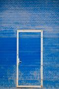 Blue door to garage Stock Photos