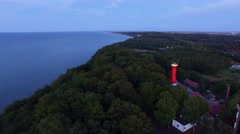 Aerial:lighthouse on the Baltic Sea at night Stock Footage