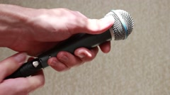 Connecting a microphone Stock Footage