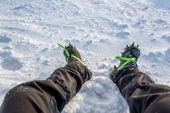 snow crampons for extreme excursions to the mountains - stock photo