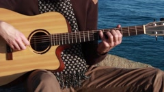 Guitar playing on the seashore Stock Footage