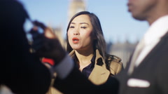 4K Businesswoman or politician giving live interview to reporters in London - stock footage