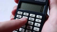 Man calculates profit on a calculator - stock footage