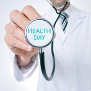 doctor shows a stethoscope with the text health day - stock photo