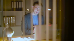 The young businessman communicates with the client on Skype - stock footage