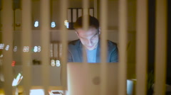 The young businessman talks on Skype to the customer - stock footage