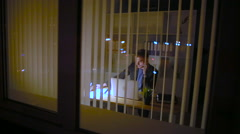 The young businessman works at night in time to hand over work Stock Footage