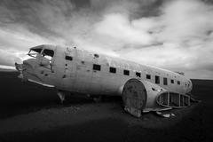 Airplane wreck on a black beach in south of Iceland Stock Photos