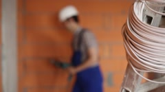 The electrician works with a drill Stock Footage