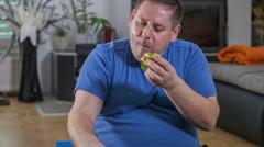 Eating a hamburger when exercising Stock Footage