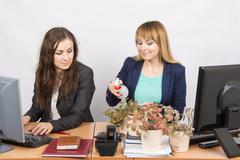 Office employee hostile looks at the Colegio, obsessed houseplants Stock Photos