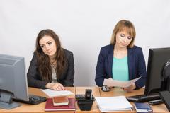 Office Workers of despondently sitting at a desk - stock photo