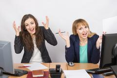 Two employee in the office expressed elation - stock photo