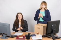 The dismissal of colleagues is joy in the office employee Stock Photos