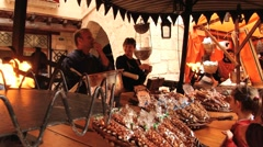 People buy sweets at the street market in Montblanc, Spain. Stock Footage